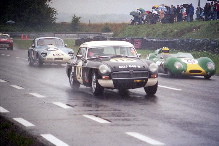 Two MGB's, one Speedwell sprite and a Lotus in the rain - Chimay Historicar 2005
