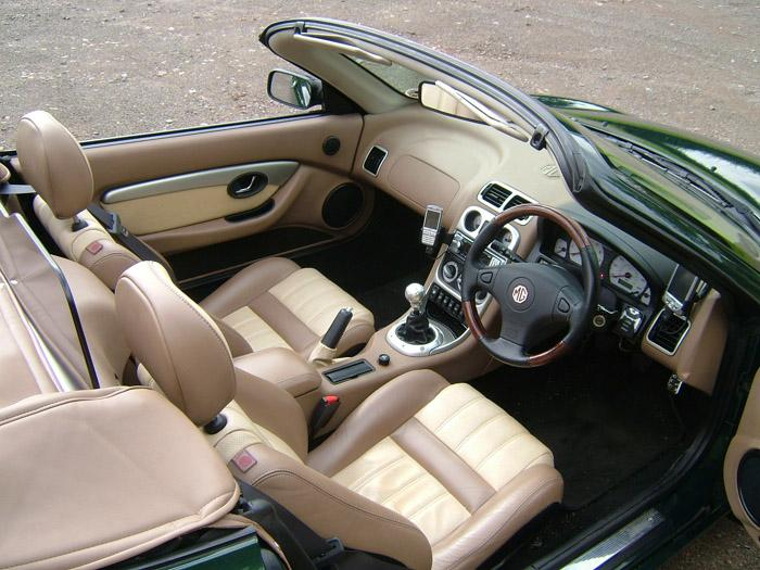 Walnut interior showing mobile phone holder and GPS.