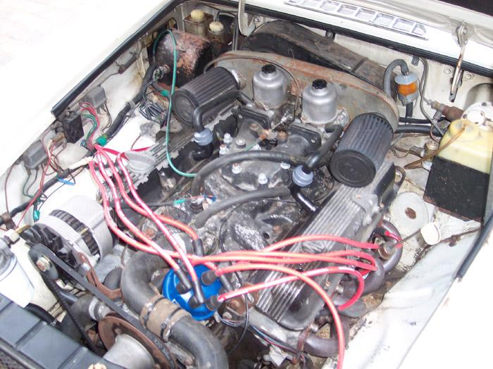 The car just purchased! Engine bay prior to top end re-build