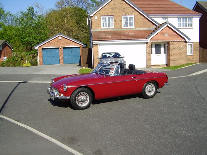 Freshly cleaned a polished MGB 79 in Damask Red with chrome conversion and wire wheels, leather seats. My pride and joy