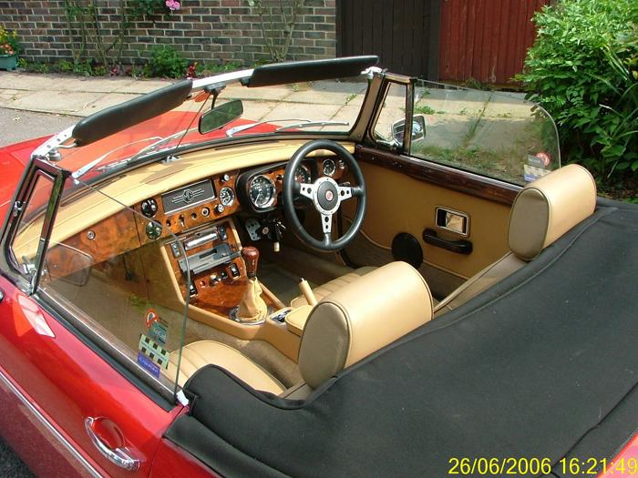 Tan and walnut interior.