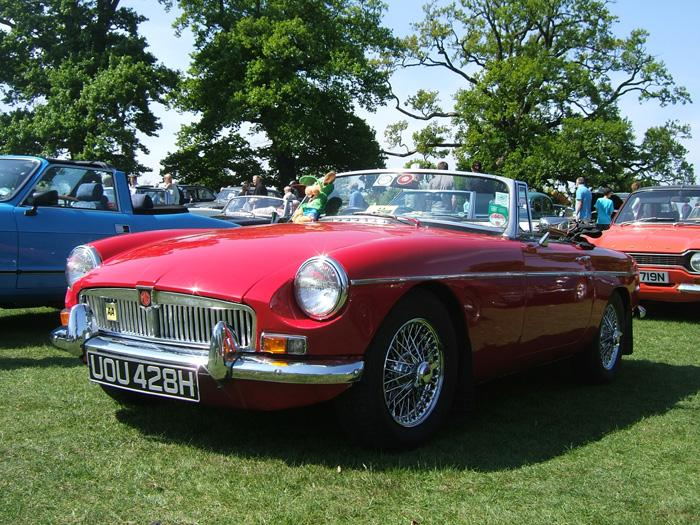 1970 MGB roadster, tartan red called Hamish. My first MG